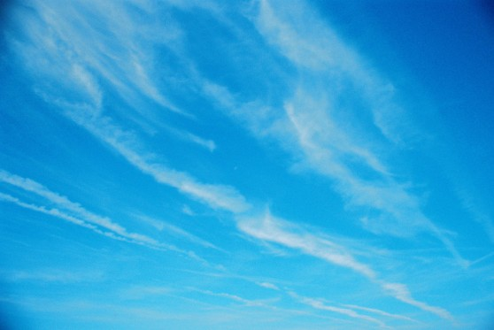 Cloud-streaked blue sky shot on 35mm film with a La Sardina camera